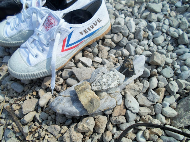 Collection of stones and Feiyue Kung Fu sneakers