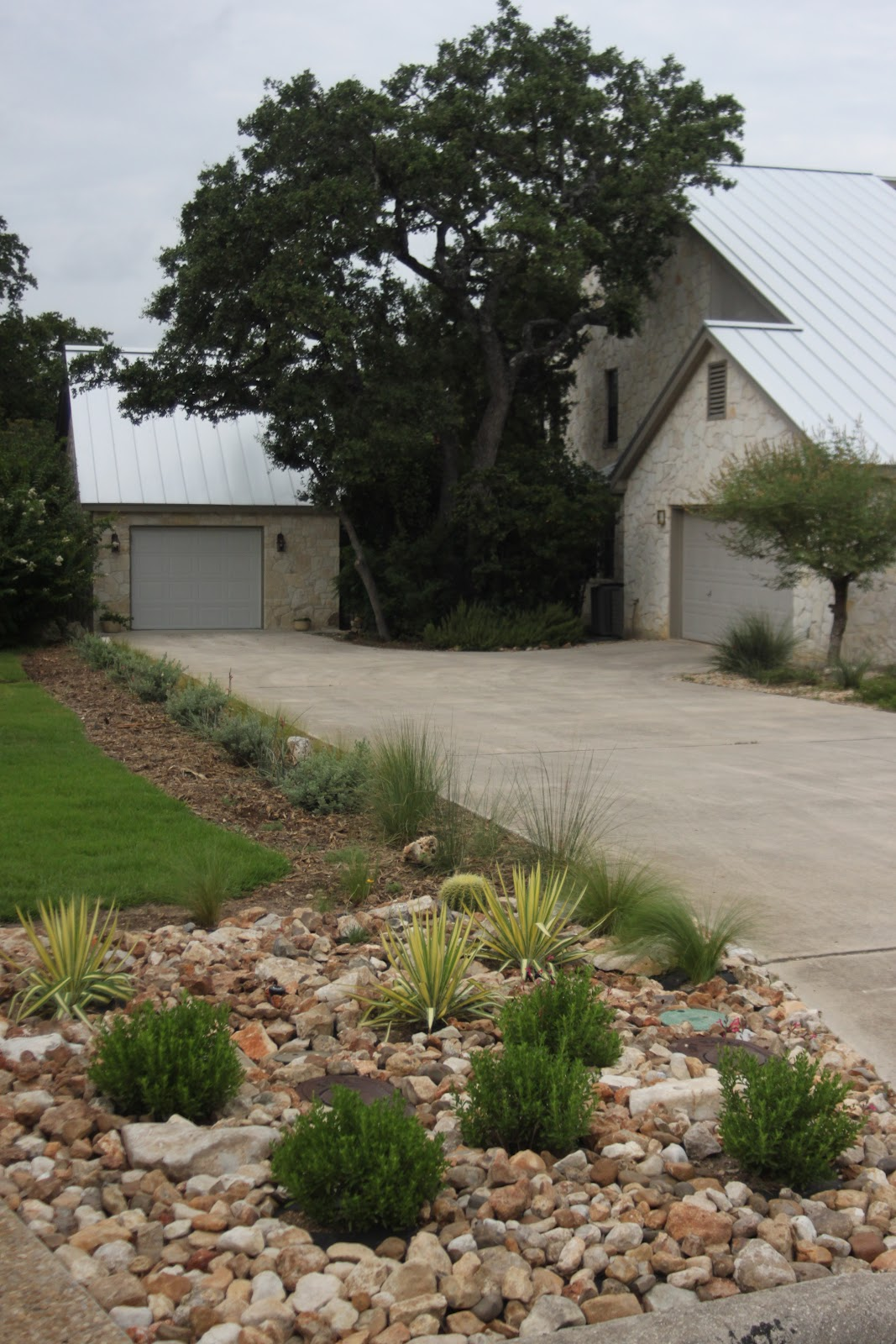 Rock oak deer driveway landscaping completed for House garden driveway designs