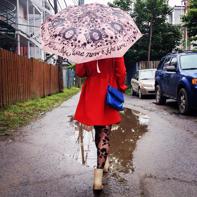 pink umbrella red raincoat floral tights beige rainboot