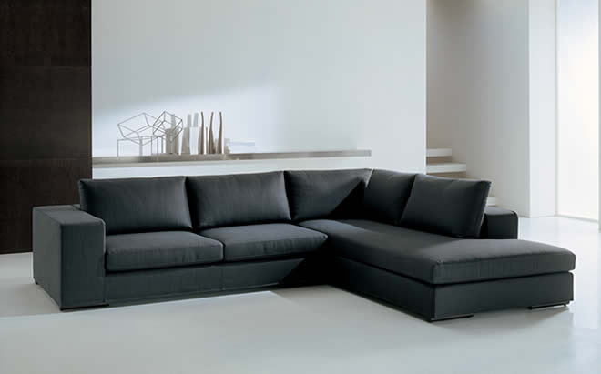sleek modern furniture. An Example Is A Sleek Modern Sofa, Which Pairs With Round Cocktail Table That Mellows The Lines. Glass In Will Make It More Modern, Whereas Wood Furniture