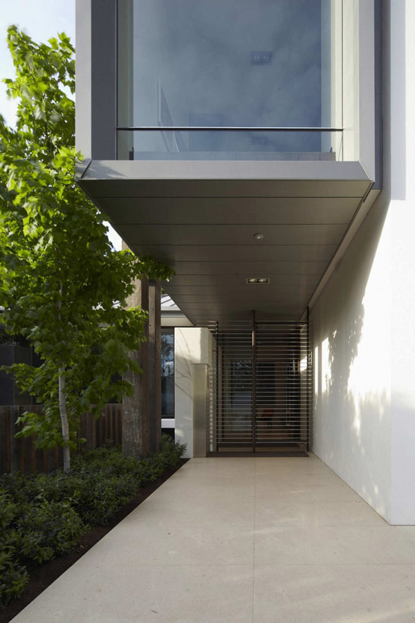Photo of covered entrance into the modern home