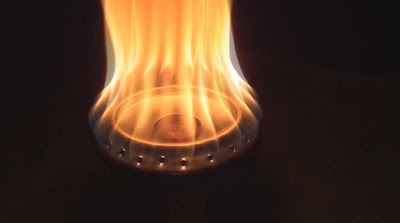 Flames roar out of a Penny stove / Beer Can stove