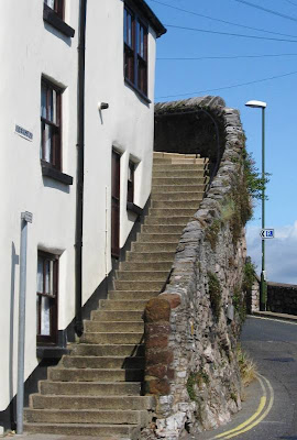 Stone steps at the side of a white painted house
