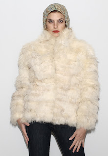 Vintage 1970's fluffy long sleeved white arctic fox fur coat.