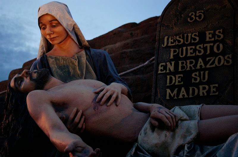 Mother Mary holding a dead Jesus.