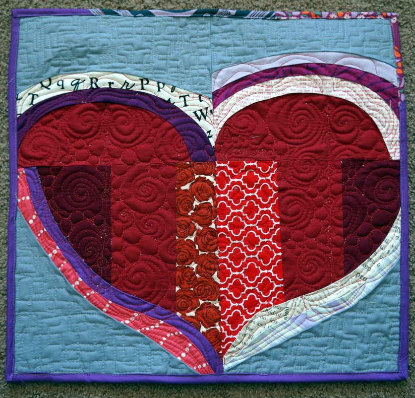http://quiltyhabit.blogspot.com/2014/02/love-someone-mini-quilt.html