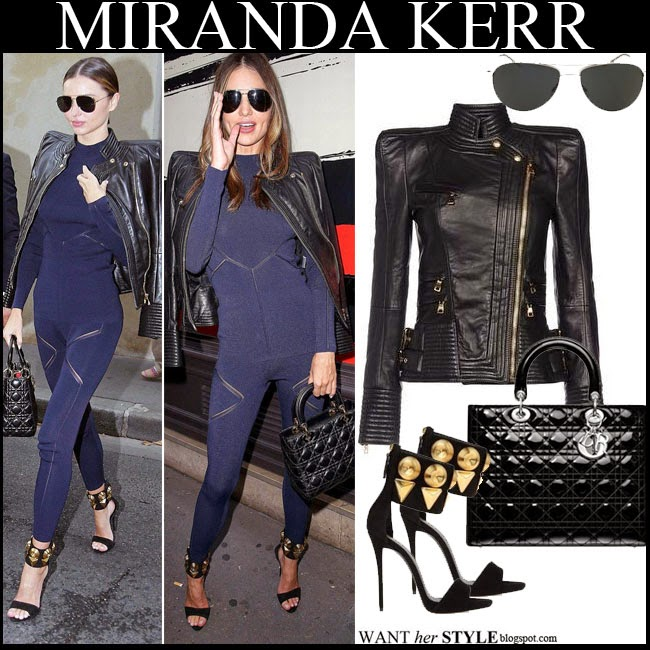 Miranda Kerr in black leather jacket, blue jumpsuit with black sunglasses, black quilted bag and black ankle strap sandals want her style september 29 paris fashion week