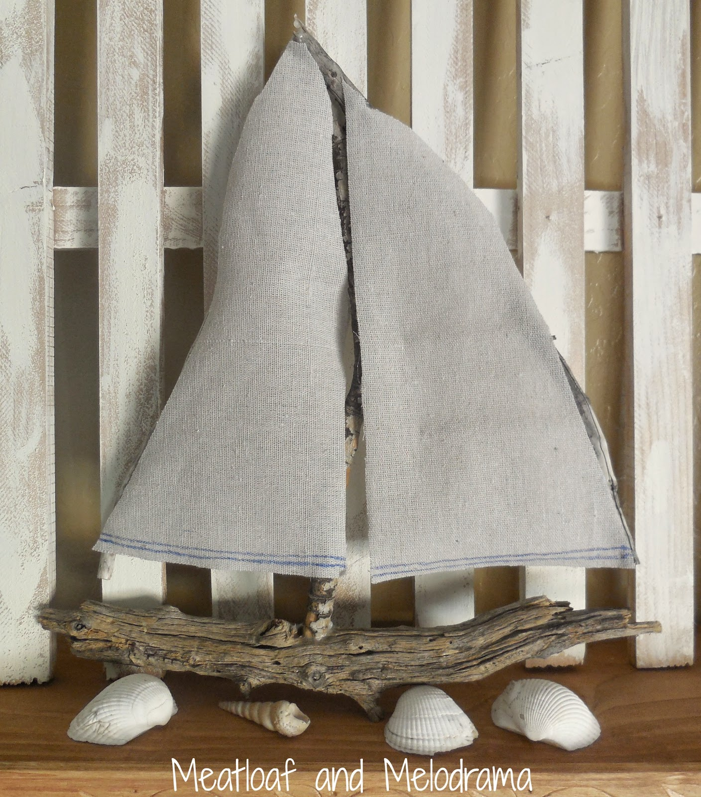 sailboat made from drop cloth and branches