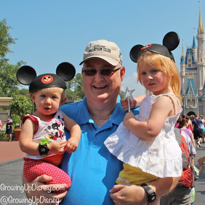 toddler and preschooler with grandfather at Disney World