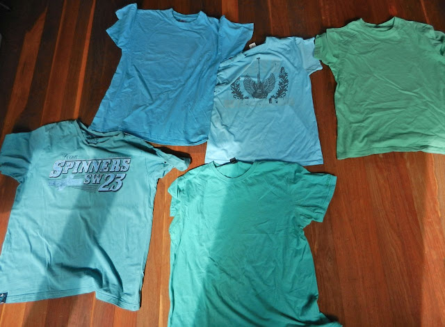 five men's blue t-shirts
