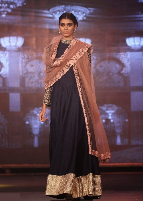 new year was preceded by a manish malhotra fashion show with heavy embroidery mirror work patch border comes around the saree with mirror work short