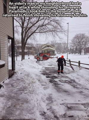 Medics shoveling driveway.