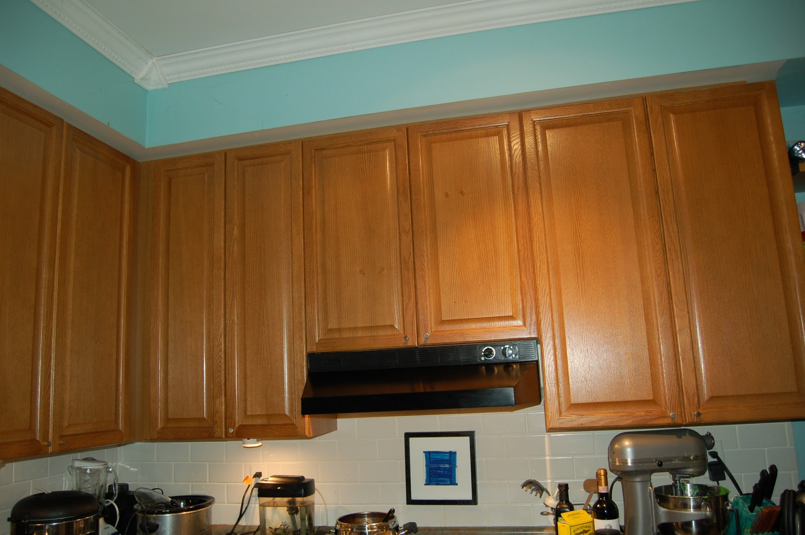 Baltic to boardwalk diy using trim to hide an ugly for Bulkhead above kitchen cabinets