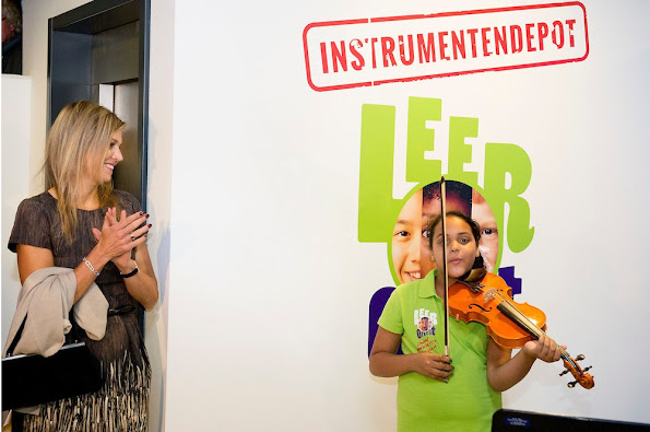 Queen Maxima of The Netherlands visit the Instrumentendepot Leerorkest and hand over the Amalia violin to Sanne Wiering in Amsterdam