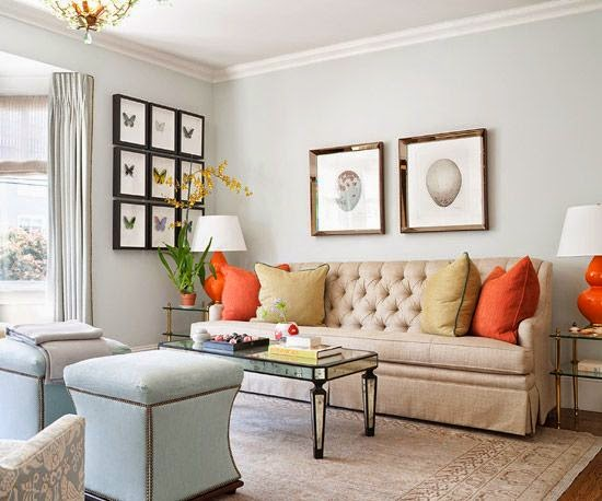 Orange Cushions And Side Table Lamps Take This Neutral Beige And Pale Blue  Living Room From Drab To Fab.