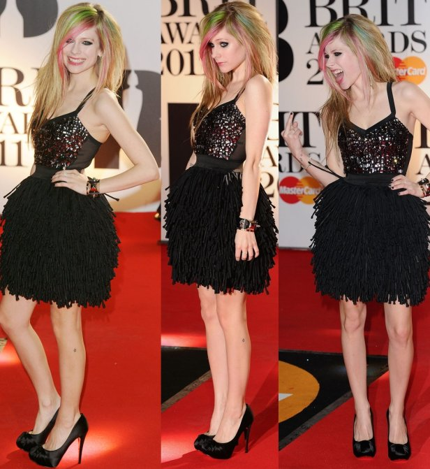 Okay, seriously, what was she thinking? Maybe she was out practising for a rock performance, then rushed for the event and forgot to change her shoes!