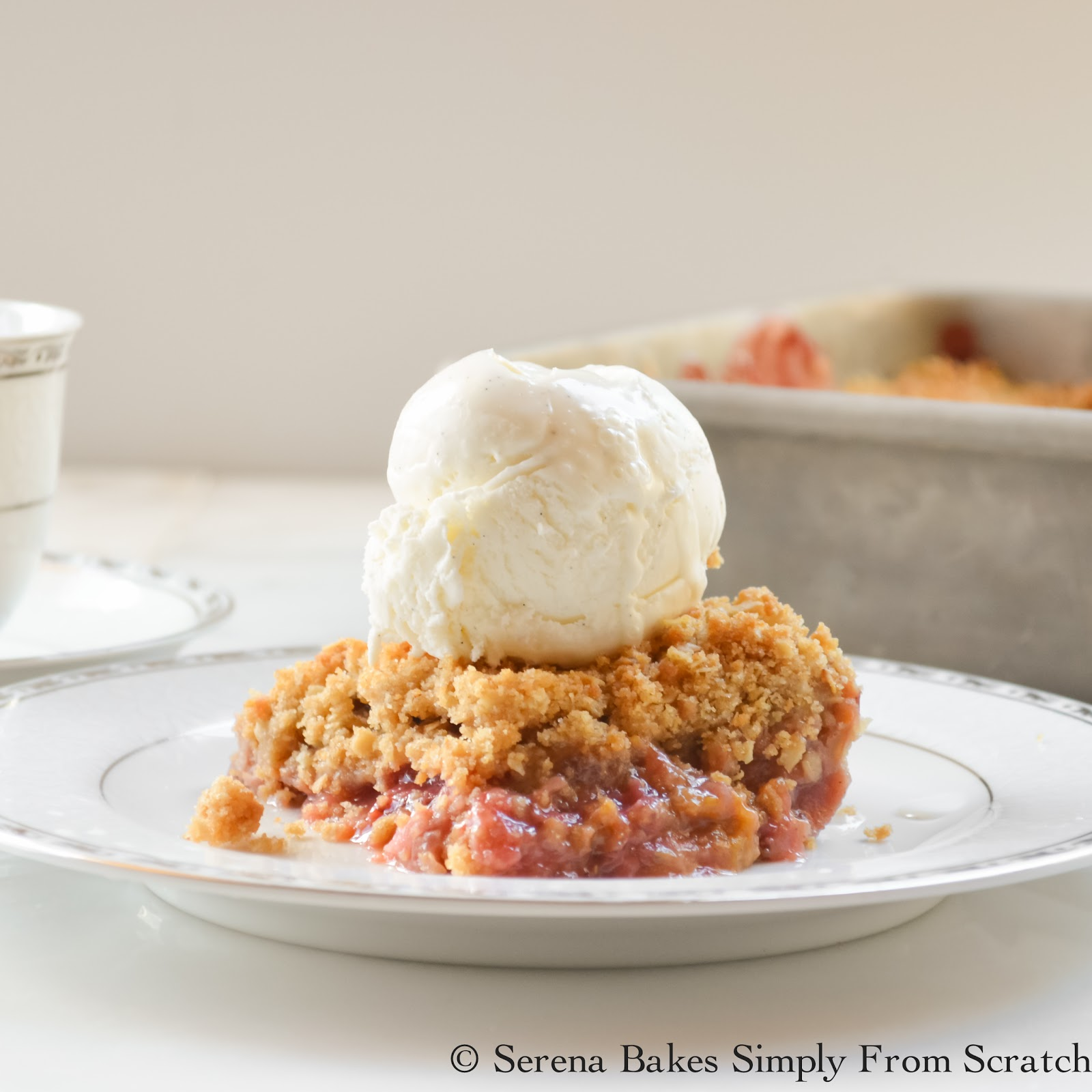 Strawberry Rhubarb Crisp is best served warm with a large scoop of Vanilla Ice Cream.