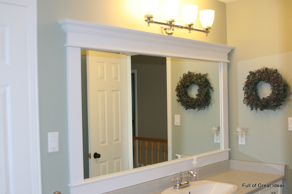 Full of great ideas framing a builder grade mirror that for Bathroom wall mirrors