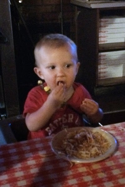 Reef Indy enjoying his after-game  spaghetti at Filippi's Pizza Grotto.