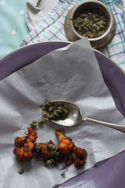 Fried cauliflower florets with capers. Gluten-free