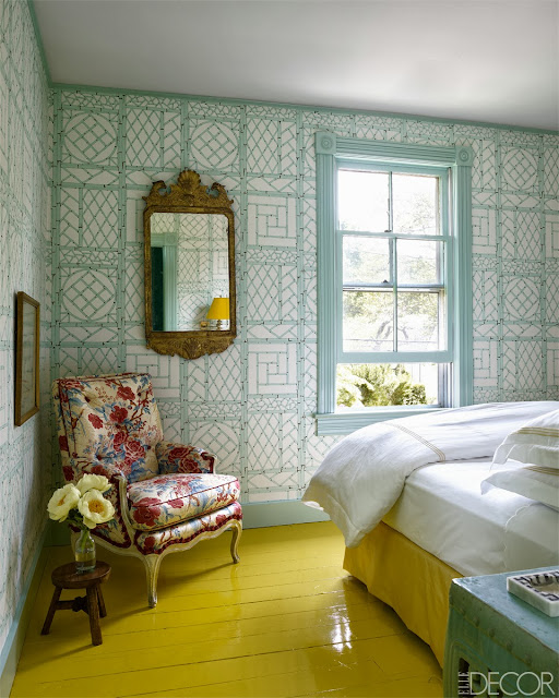 Bedroom in Oscar PR Girl's weekend home with a glossy yellow floor and light blue trellis wallpaper