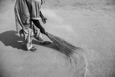 man sweeping