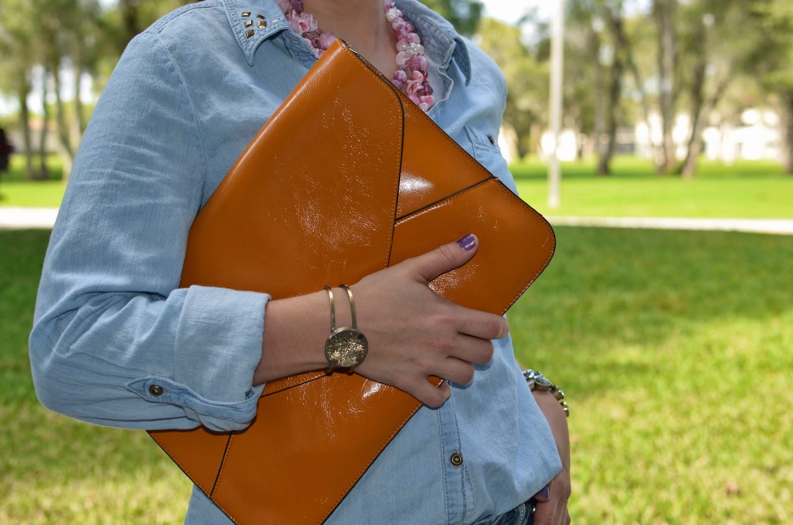 leather envelope clutch - statement necklace