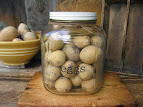 Old Storage Jar filled with Egg Gourds