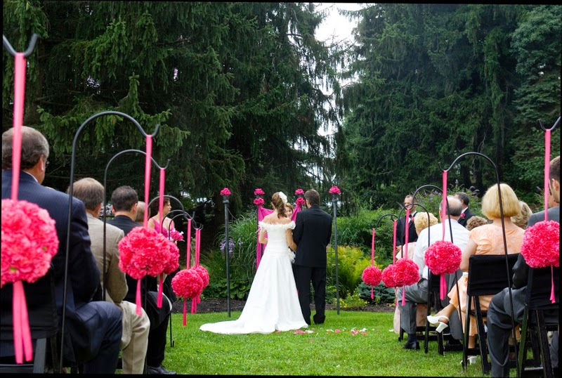Black white and pink outdoor wedding ceremony.