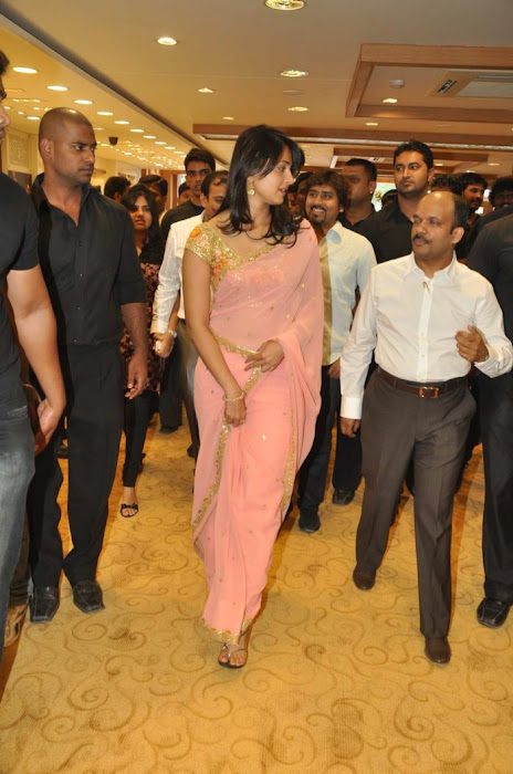 Anushka Shetty in Mustard Saree and Golden Blouse in a Shopping mall cute stills
