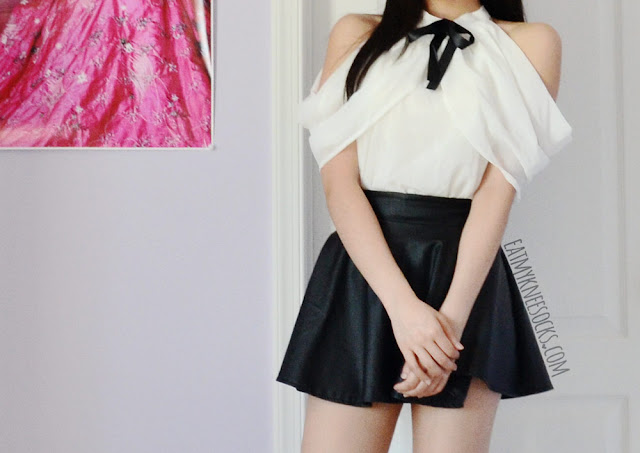 A cute, ulzzang-inspired punk schoolgirl outfit featuring Dresslink's ribboned off-shoulder white blouse, worn with a faux leather skater skirt.