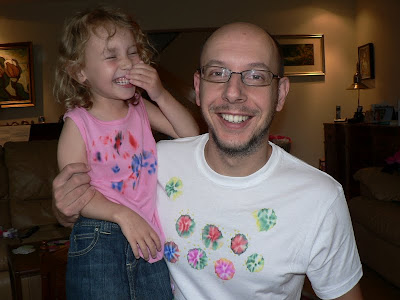 daddy and daughter giggling in their matching DIY tie-dye t-shirts