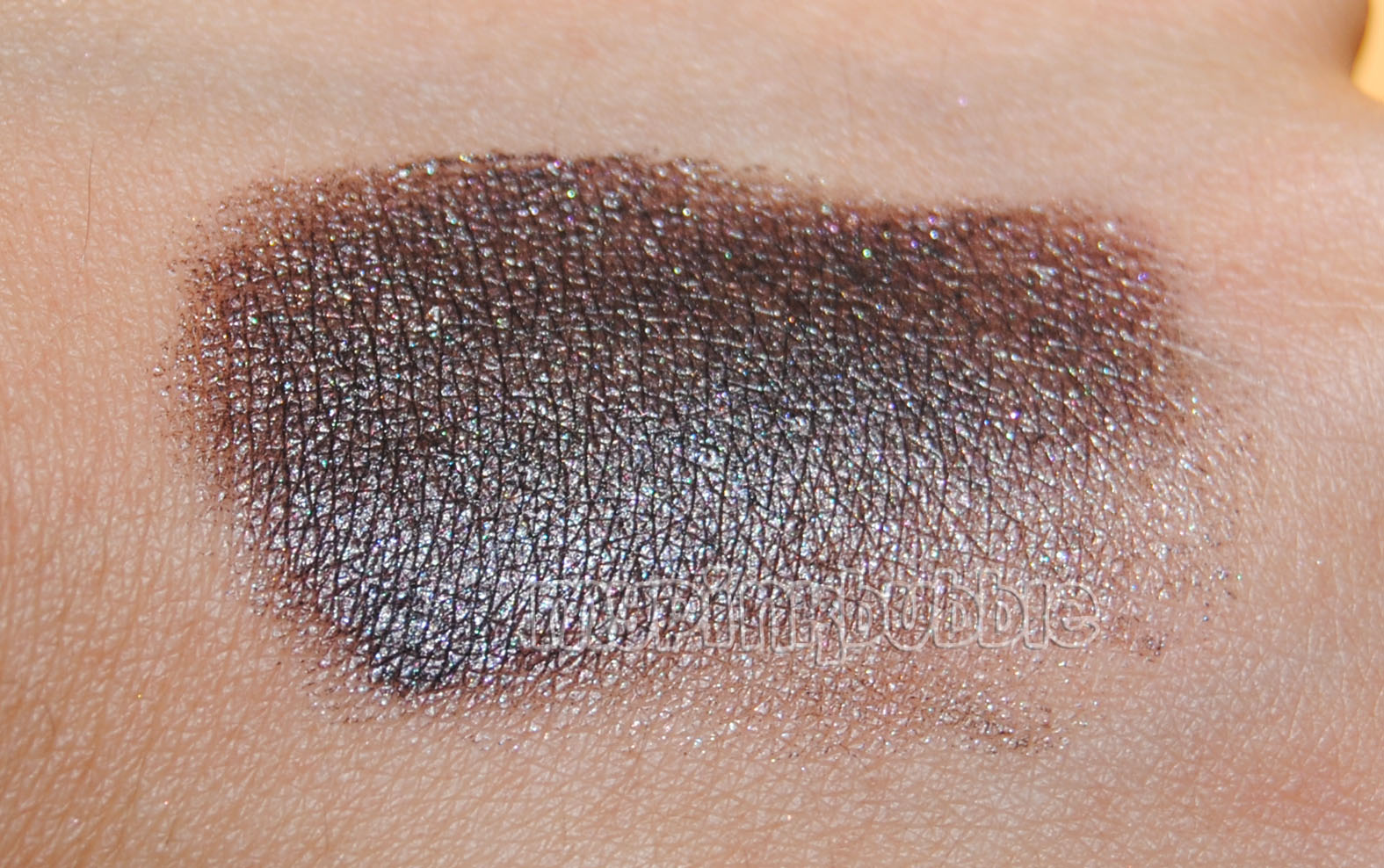 kiko 103 Alternative Brown swatch