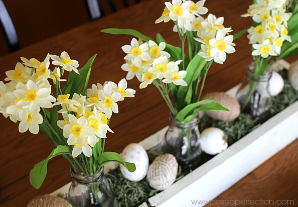 Love how cheery the light yellow daffodils are in this Rustic Springtime Centerpiece.
