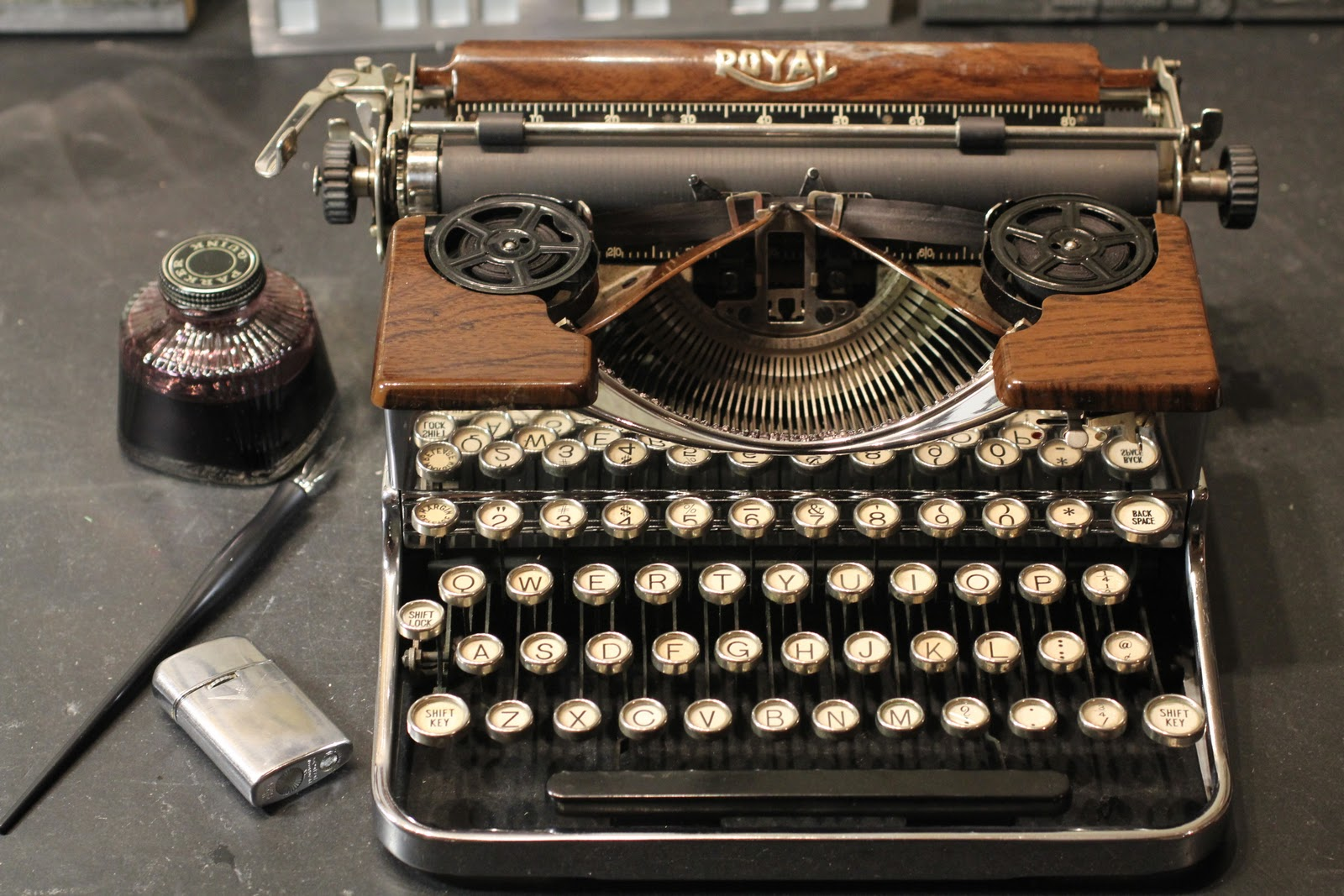 Vintage Royal Portable Typewriter Part - 31: Here Is The Chrome And Wood Grain Royal Portable Looking Shiny And Clean.  For The Record, I Donu0027t Smoke, But The Lighter Seemed To Fit The Scene.