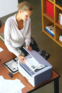 happy woman office worker using printer scanner