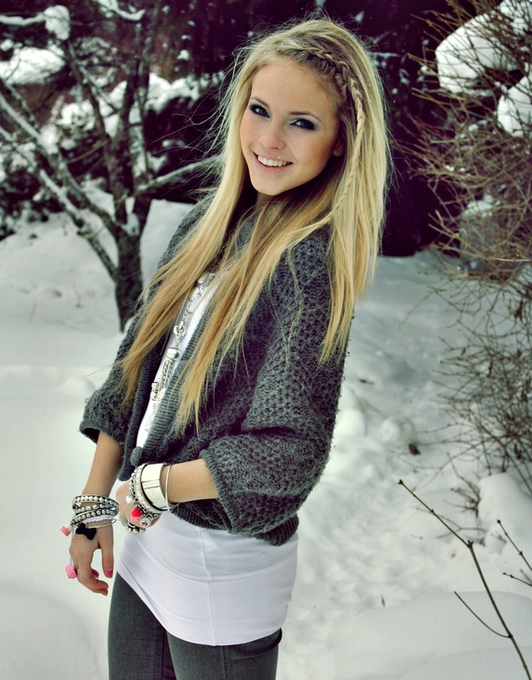 Pretty Girl with Blonde Hair in Snow