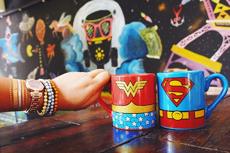 Super man and wonder woman mugs