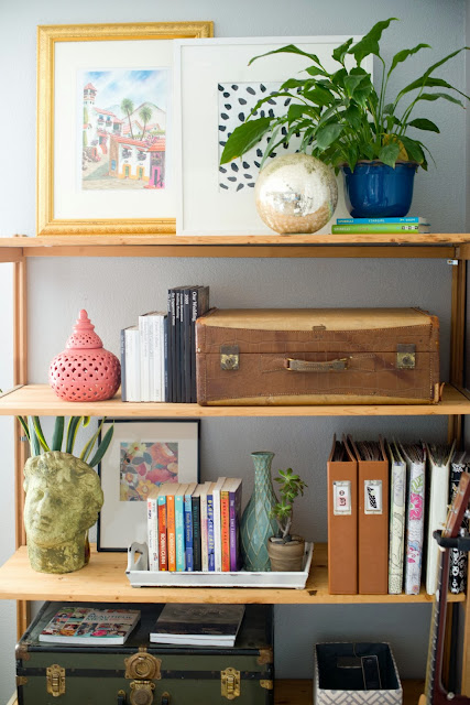 Styling a shelving unit that is both pretty and functional.