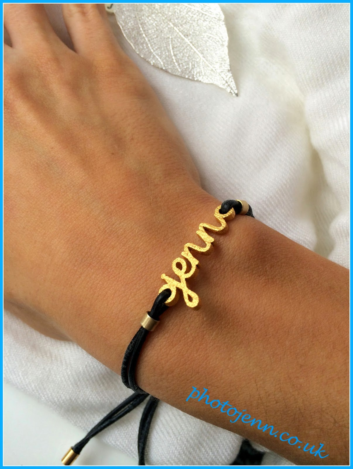 Zazzy-personailsed-name-bracelet-wordplay-gold--black-cord