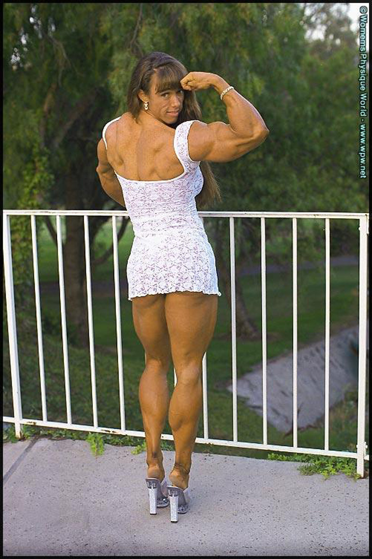 Denise Hoshor Flexing Her Massive Bicep And Muscular Calves In A White Dress