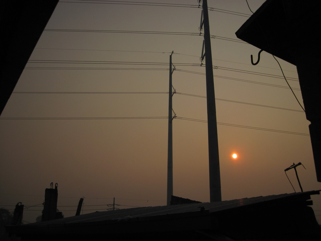 Rising sun in the east but is orange-colored due to smog that came from New Year's Eve celebration.  (Photo by Bernard Eirrol Tugade)