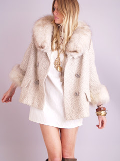 Vintage 1960's cream colored tweed wool coat with fox fur trim and double breasted front closure.