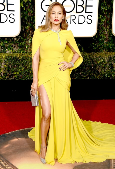 Jennifer Lopez stuns in a bright yellow caped gown at the Golden Globes 2016