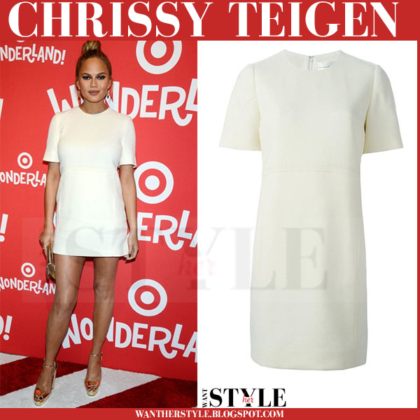 Chrissy Teigen in white short sleeve victoria beckham mini dress and gold kurt geiger hero sandals what she wore red carpet