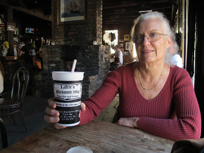 Joan enjoying a Hurrican cocktail at Lafitte's Blacksmith Shop