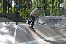 Having fun at a skate park.