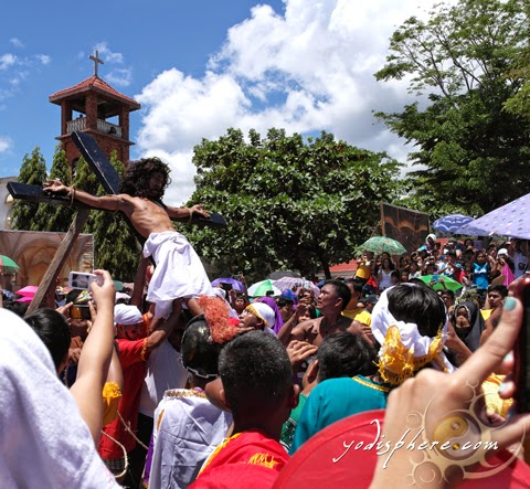 Man with his palms and feet nailed in cross as part of Holy Week celebration