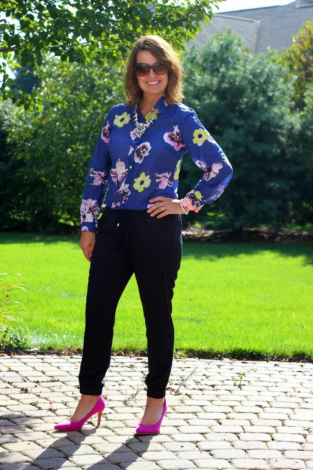 J Crew Factory floral print blouse, black drapey pants, joggers, pink pumps, statement necklace