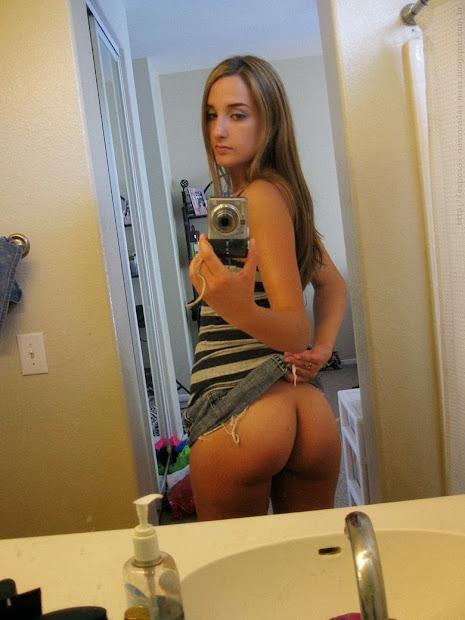 teen taking selfie of her own butt